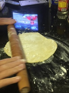 Make putting the pie dough easy by first rolling it on your rolling pin!