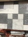 We debated a number of tiles and settled on this - $11.99 for each 12 by 12 square.