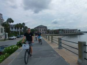 Riding bikes along the water, you can see Fort Sumter.